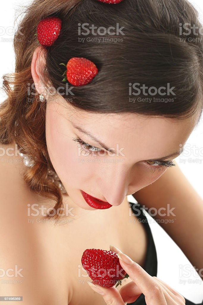 woman eating strawberry royalty-free stock photo