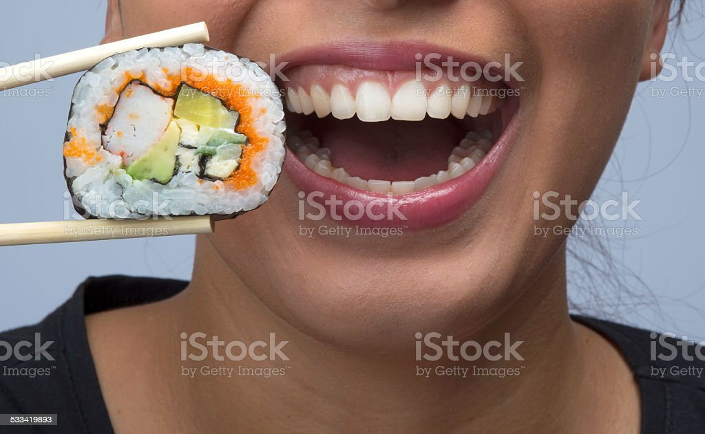 woman eating sushi royalty-free stock photo