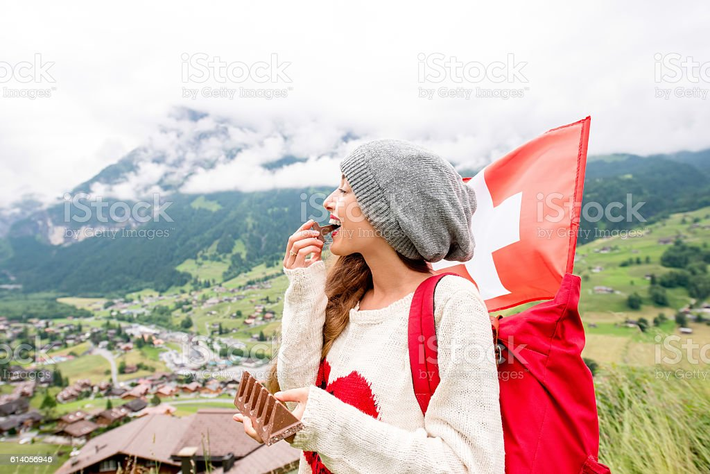 Woman eating swiss chocolate stock photo