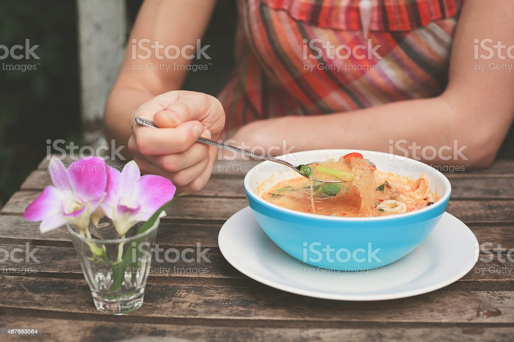 Woman eating tom yum soup royalty-free stock photo