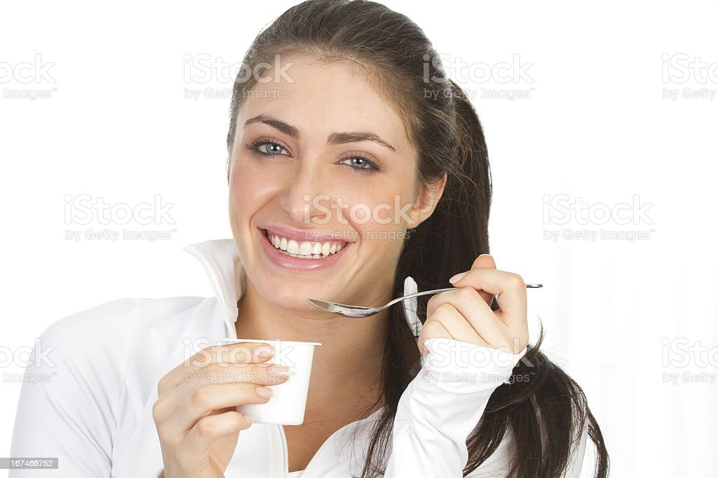 woman eating yogurt royalty-free stock photo
