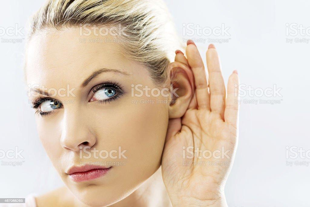 Woman eavesdropping. royalty-free stock photo