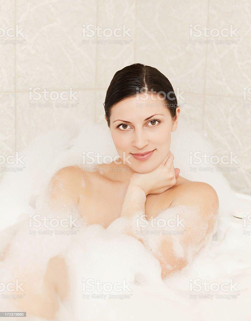 Woman ejoying bubble bath royalty-free stock photo