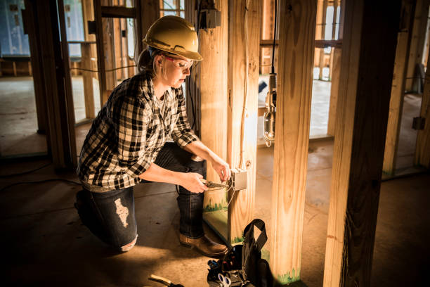 Woman electrician at home construction site. stock photo