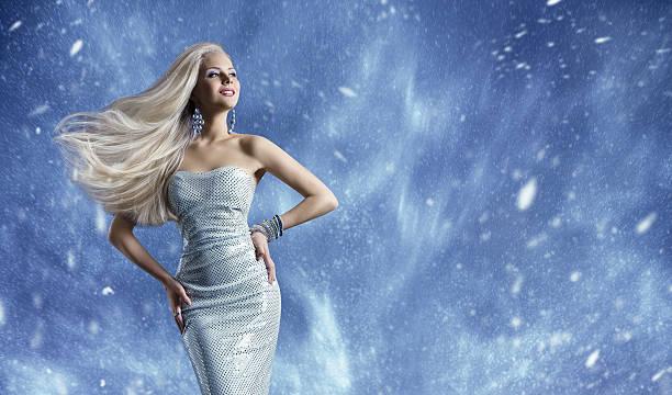 woman elegant fashion dress, long hair waving, winter model beauty - abendkleid lang blau stock-fotos und bilder