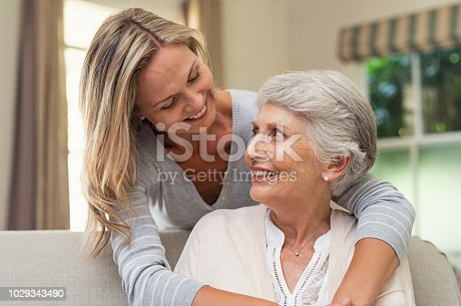 istock Woman embracing senior mother 1029343490