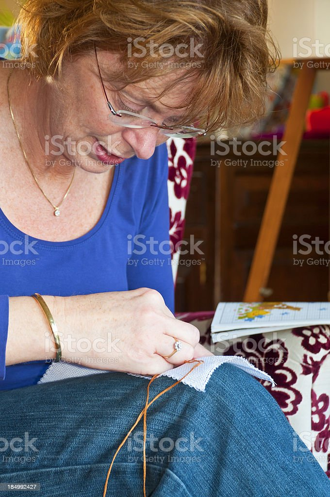 Woman Embroidering royalty-free stock photo