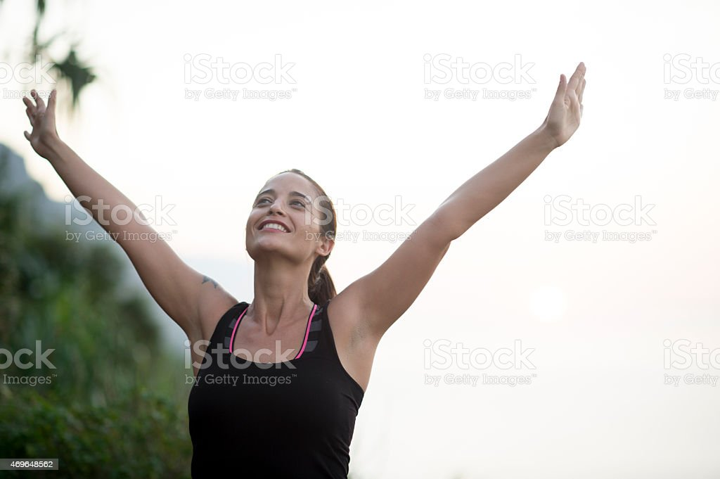 Woman Emerging Victorious stock photo