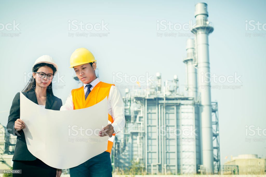 Woman Engineer And Men Engineer Work New Project In Power