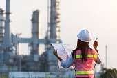 istock woman engineer and working new project in power plant, Engineer Concept,professional,safety,industry 941778856