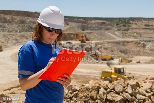 istock woman engineer at mine 591425058