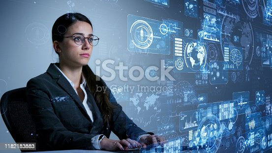istock woman engineer concept. GUI (Graphical User Interface). System engineering. 1182183883