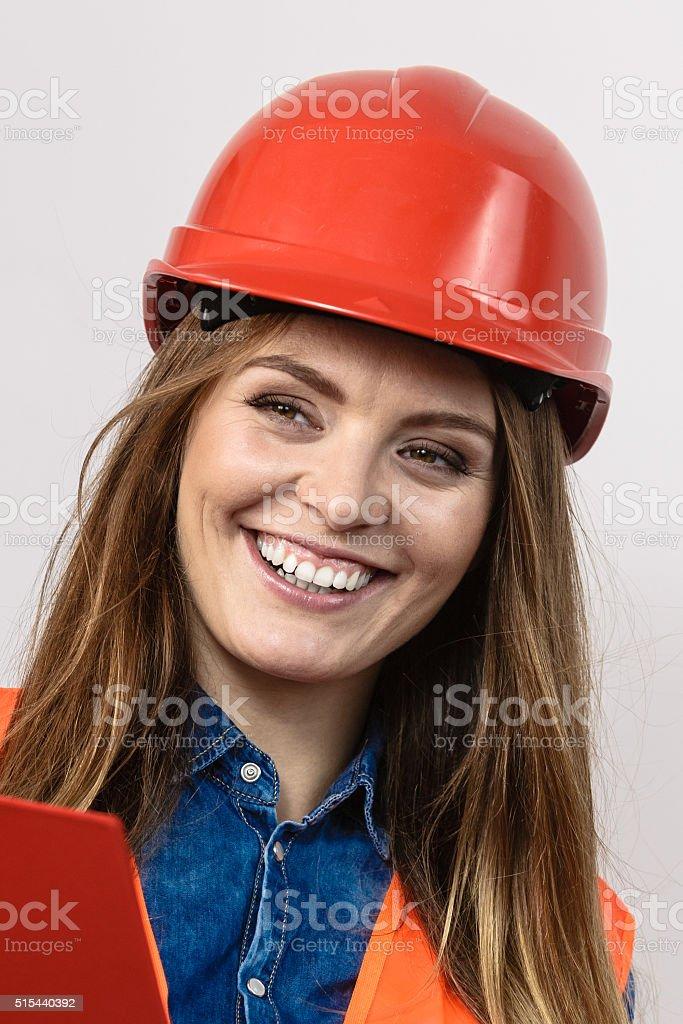 Woman engineer construction builder in helmet. stock photo