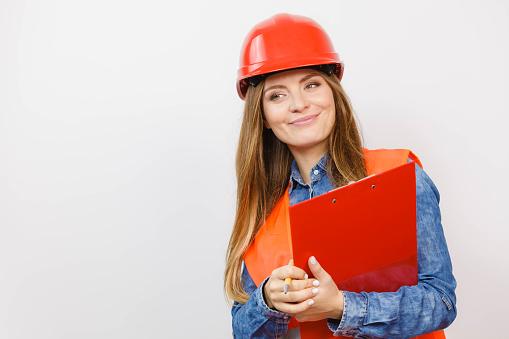 Woman Engineer Construction Builder In Helmet Stock Photo - Download Image Now