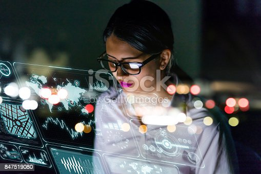 istock woman engineer looking at various information in screen of futuristic interface. 847519080