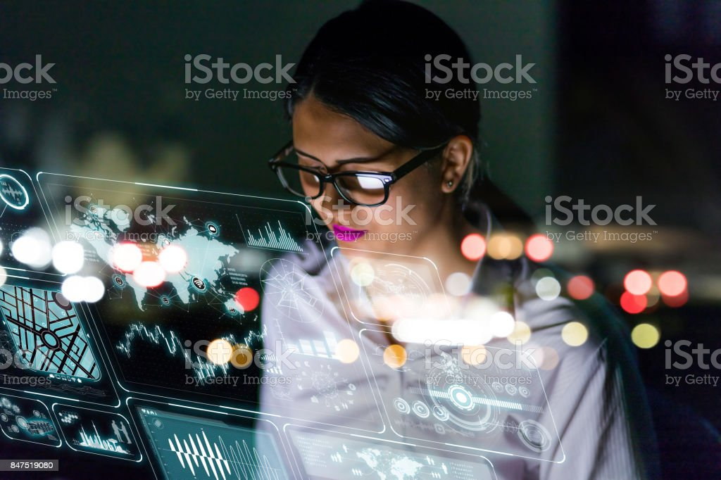 woman engineer looking at various information in screen of futuristic interface. - foto stock