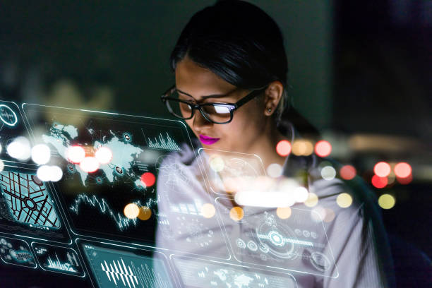 woman engineer looking at various information in screen of futuristic interface. - hologram stock photos and pictures