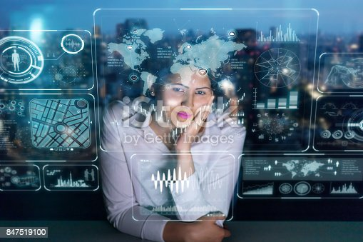istock woman engineer looking at various information in screen of futuristic interface. 847519100