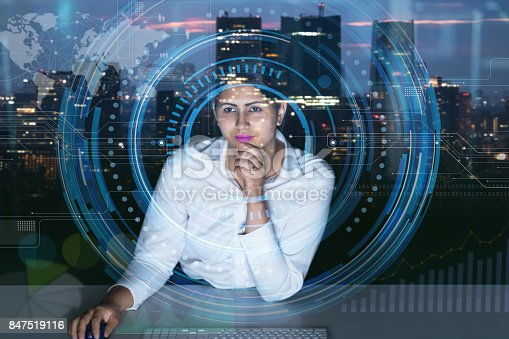 istock woman engineer looking at various information in screen of futuristic interface. 847519116