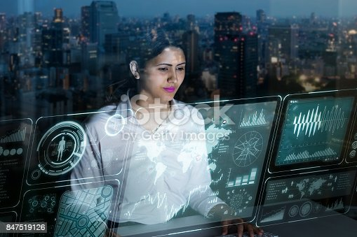 istock woman engineer looking at various information in screen of futuristic interface. 847519126