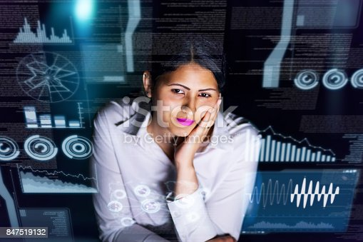 847519080 istock photo woman engineer looking at various information in screen of futuristic interface. 847519132