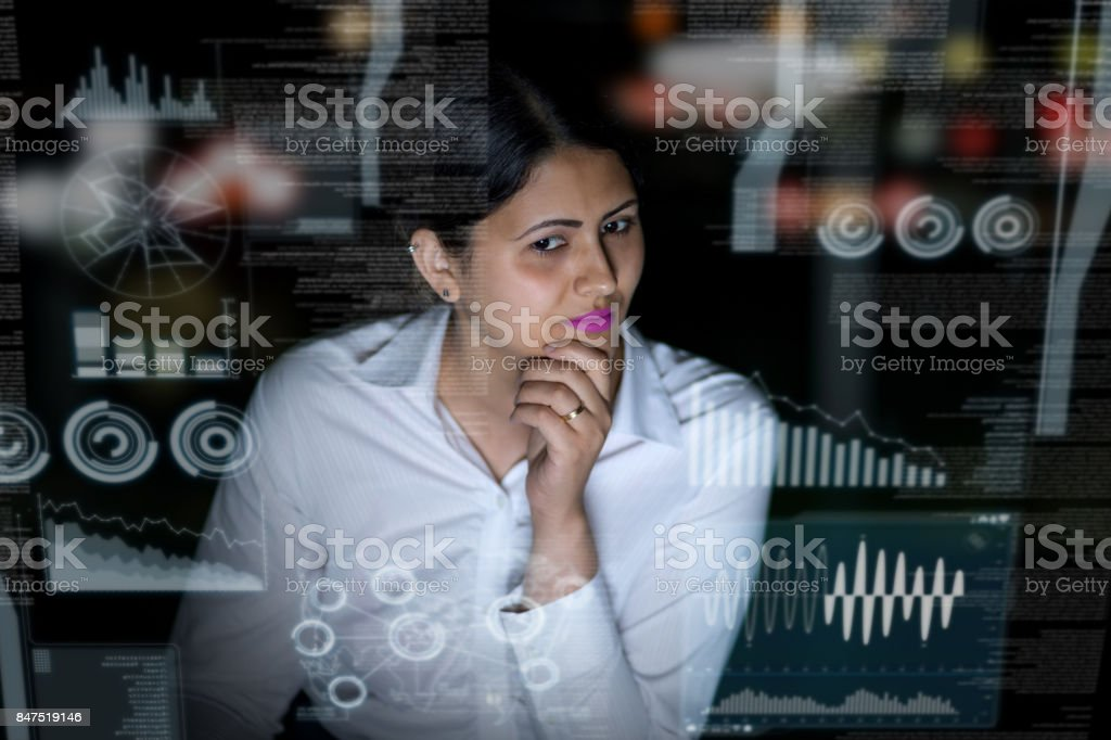 woman engineer looking at various information in screen of futuristic interface. stock photo