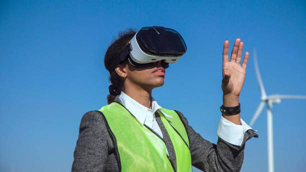 Woman engineer with virtual headset Footage of woman wearing virtual reality headset moving her hands around in the air as the camera rotates around her augmented reality sustainable stock pictures, royalty-free photos & images