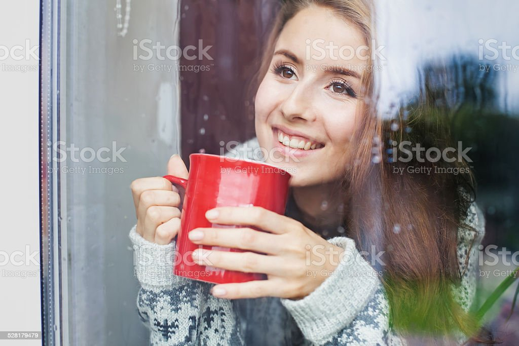 Woman enjoing morning with cup of coffee stock photo