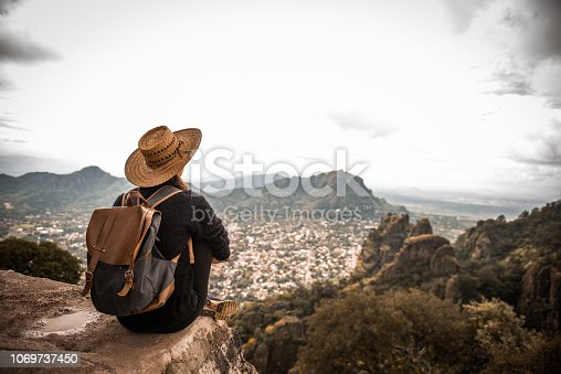 Argentinian woman traveling Mexico. She is enjoying the view on Tepoztlan, Mexico