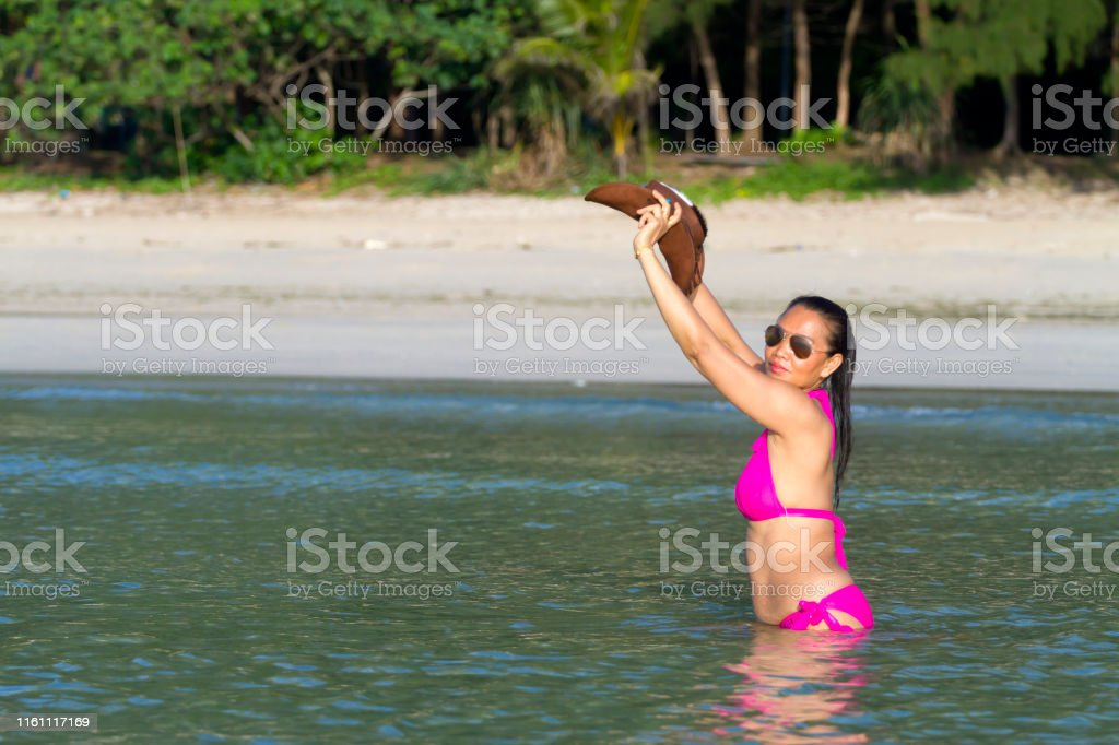 Woman enjoy bikini pink and hat on beach at Thung Wua Laen Beach,...