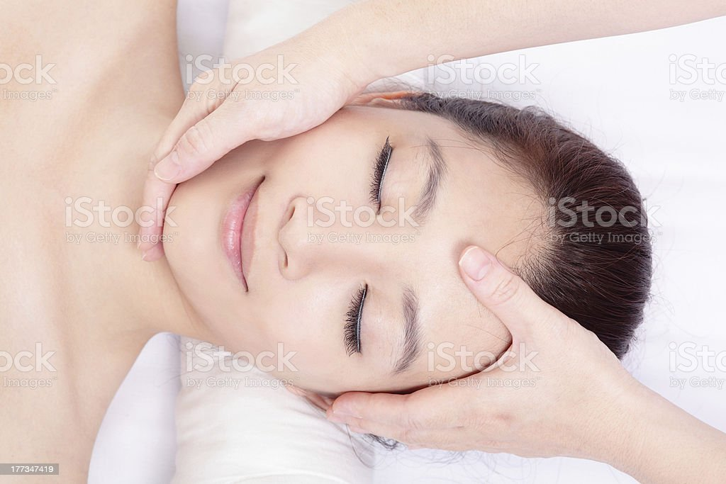 woman enjoy receiving face and head massage stock photo