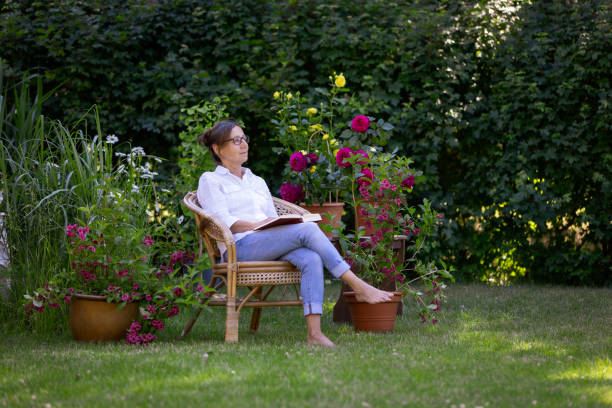Woman enjoy relaxing in the garden stock photo