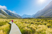 Summertime , woman enjoy travel at mount cook national park in south Island New Zealand