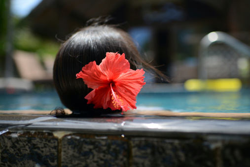 545091450 istock photo Woman Enjoy Vacation In Swimming Pool 174924839