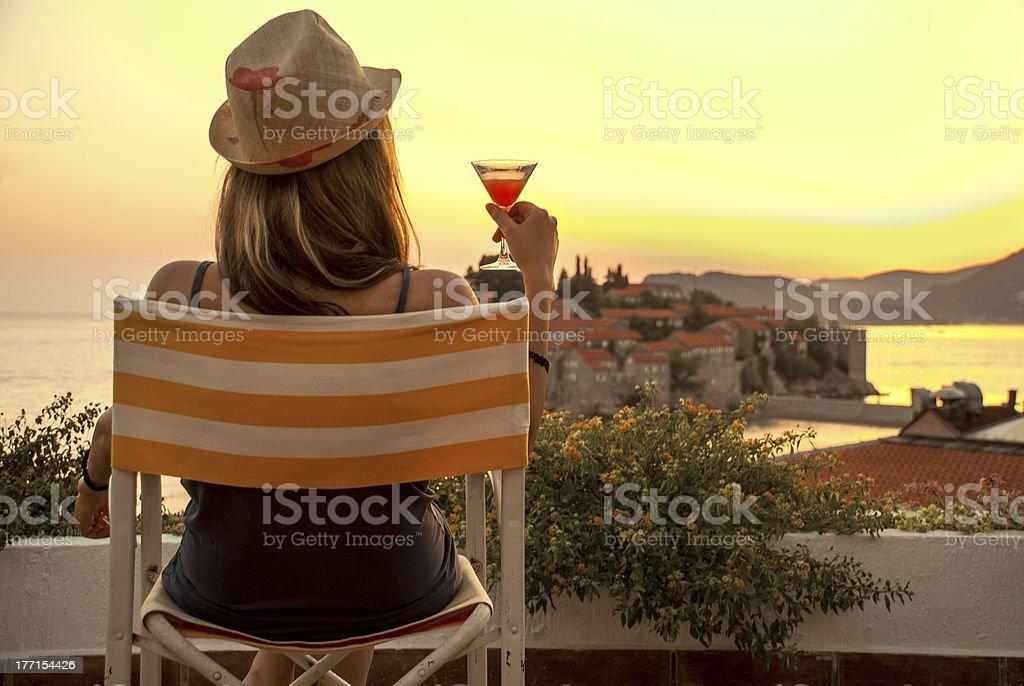 woman enjoying a beautiful sunset royalty-free stock photo