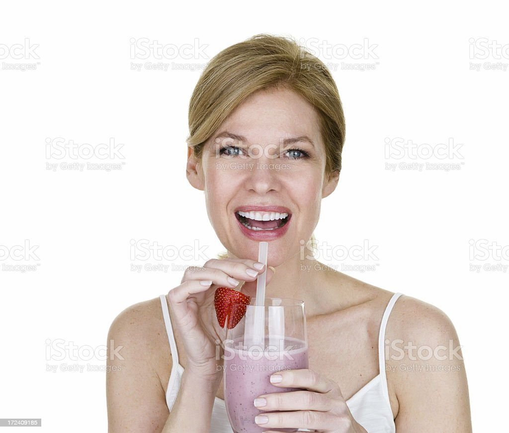 Woman enjoying a fruit smoothie royalty-free stock photo