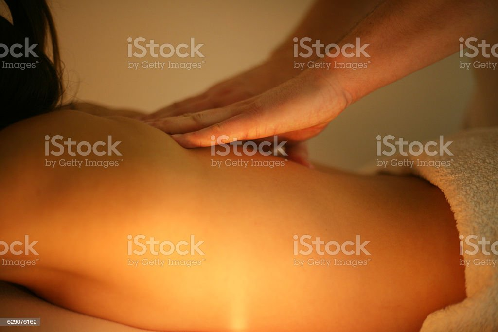 Woman enjoying a massage treatment. stock photo