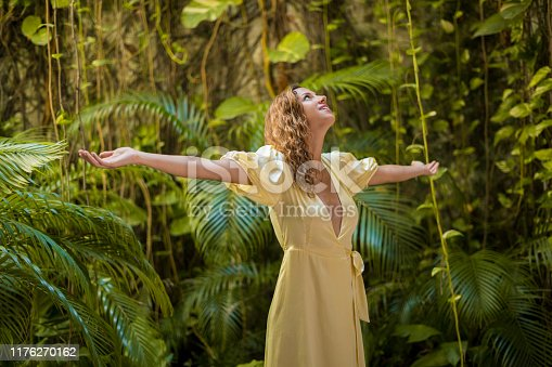istock Woman enjoying a natural environment 1176270162