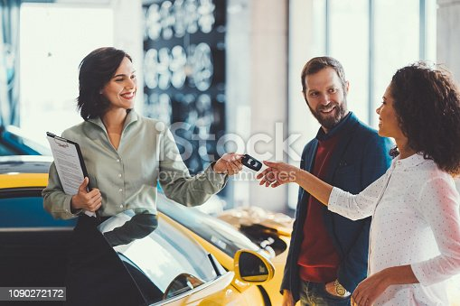 istock Woman enjoying a new car 1090272172