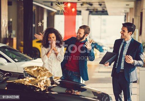 istock Woman enjoying a new car 913442248