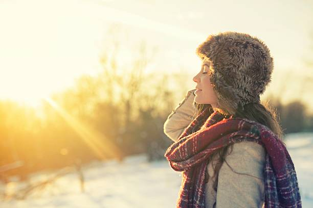 Woman enjoying a winter day on mountains stock photo