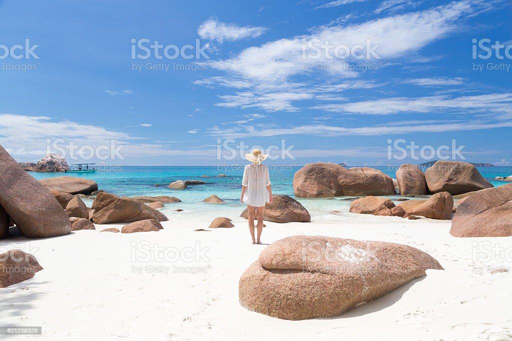 Woman enjoying Anse Lazio picture perfect beach on Praslin Island stock photo