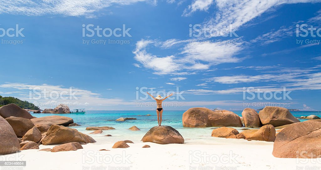 Woman enjoying Anse Lazio picture perfect beach on Praslin Island stock photo