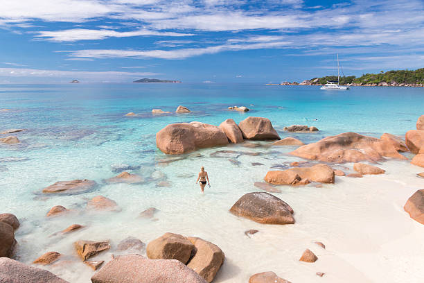 Woman enjoying Anse Lazio picture perfect beach on Praslin Island – Foto