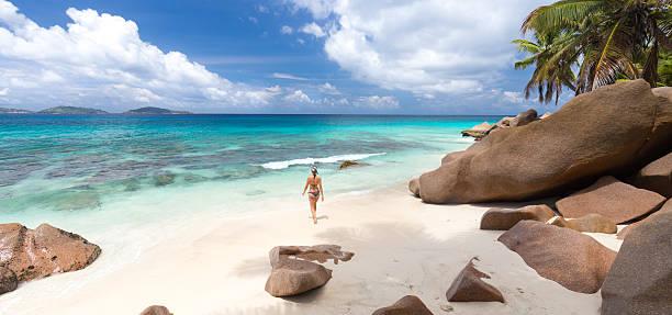 Woman enjoying Anse Patates picture perfect beach on La Digue – Foto