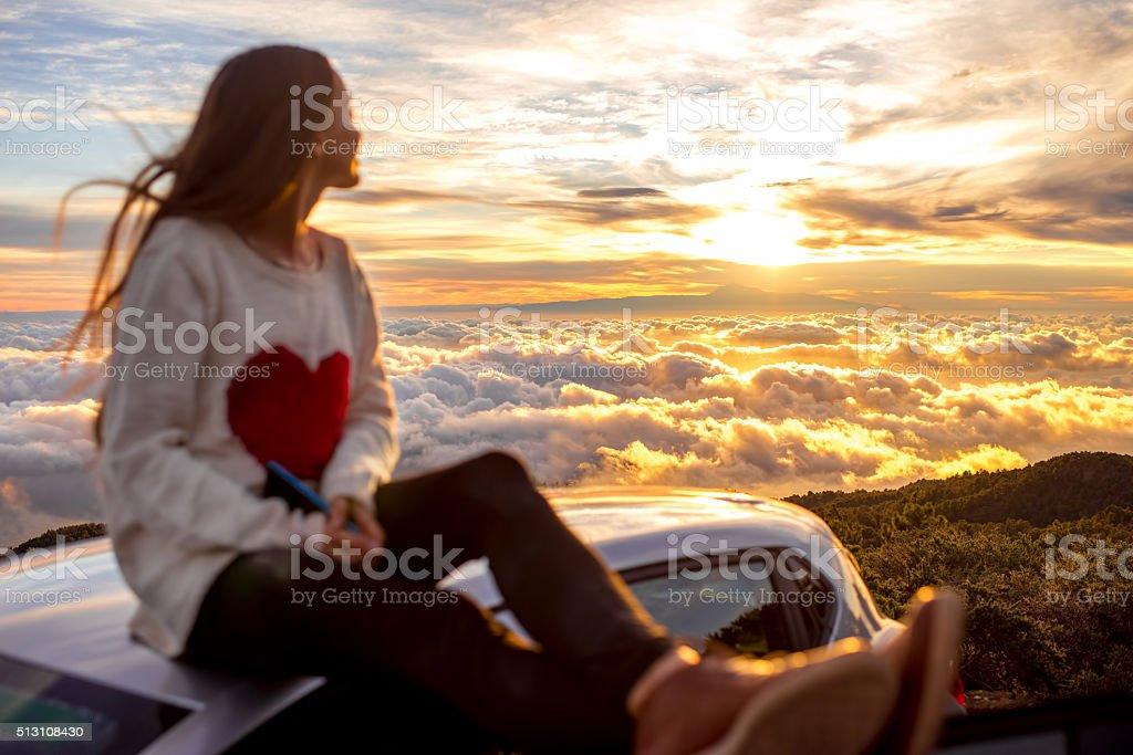 Woman enjoying beautiful cloudscape stock photo
