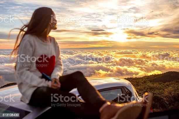 Photo of Woman enjoying beautiful cloudscape