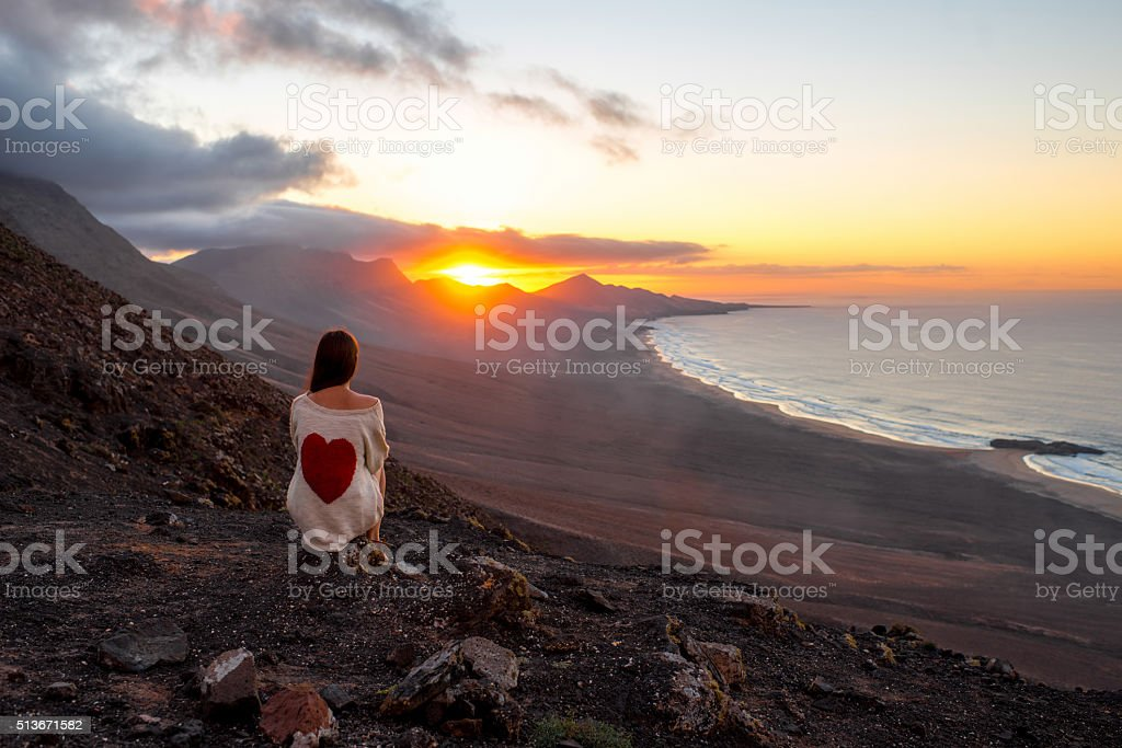 Woman enjoying beautiful landscape on Fuerteventura island stock photo