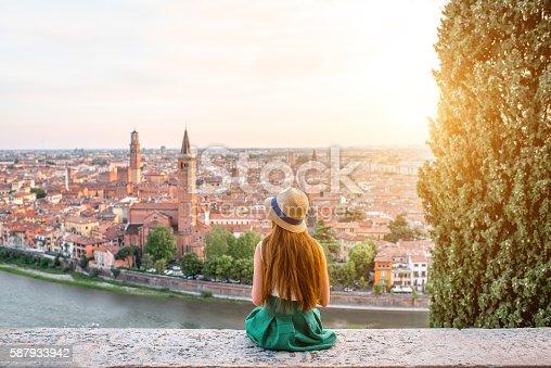 istock Woman enjoying beautiful view on Verona city 587933942