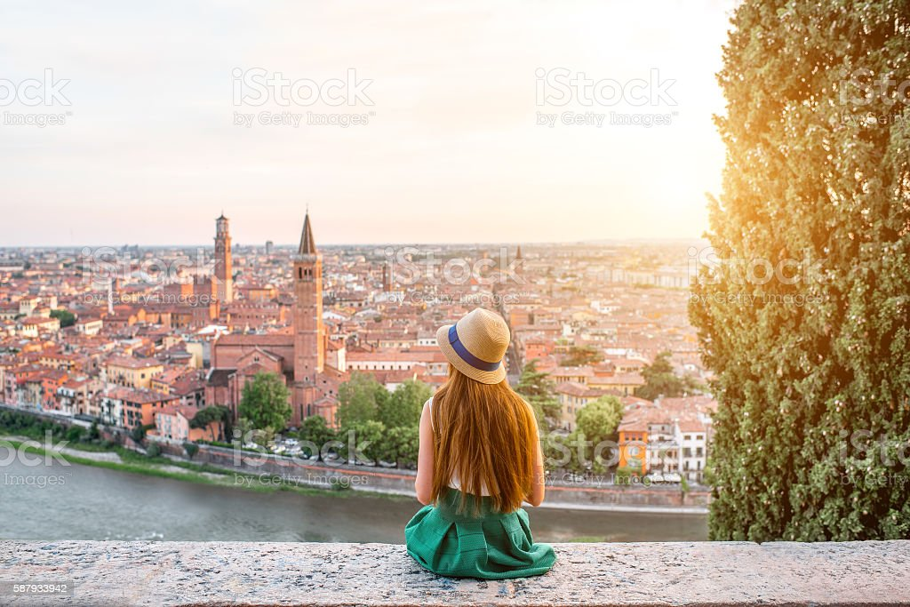 Woman enjoying beautiful view on Verona city - foto de acervo